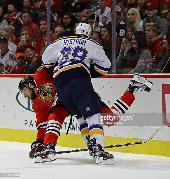 Eric Nystrom of the St Louis Blues dumps Michal Kempny of the Chicago Blackhawks during a preseason game at the United Center on October 1 2016 in...