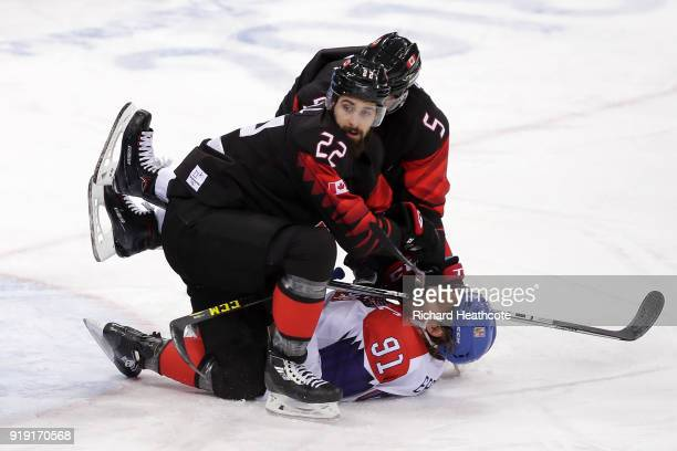 Eric O'Dell of Canada and Chay Genoway of Canada collide with Martin Erat of the Czech Republic during the Men's Ice Hockey Preliminary Round Group A...