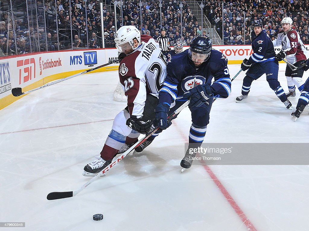 Eric O'Dell #58 of the Winnipeg Jets battles Maxime Talbot #25 of the Colorado Avalanche as they chase the loose puck during third period action at the MTS Centre on March 19, 2014 in Winnipeg, Manitoba, Canada.
