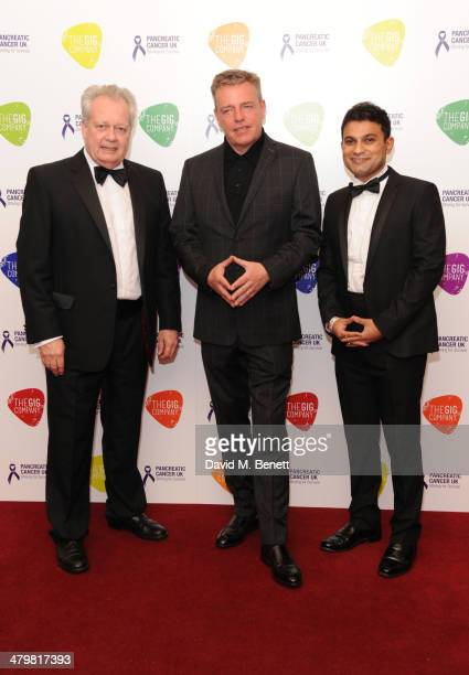 Eric Ollerenshaw OBE Suggs and Rajdeep Choudhury attends 'An Evening With Suggs and Friends' for Pancreatic Cancer UK at the Porchester Hall on March...