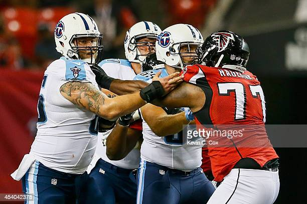 Eric Olsen of the Tennessee Titans blocks Ra'Shede Hageman of the Atlanta Falcons in the second half of a preseason game at the Georgia Dome on...