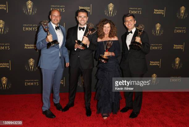 Eric Pankowski, Ben Winston, Sheila Rogers and David Young pose with the award for Outstanding Short Form Comedy, Drama or Variety Series for...