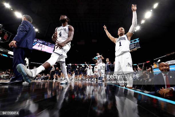 Eric Paschall and Jalen Brunson of the Villanova Wildcats celebrate in the second half against the Michigan Wolverines during the 2018 NCAA Men's...
