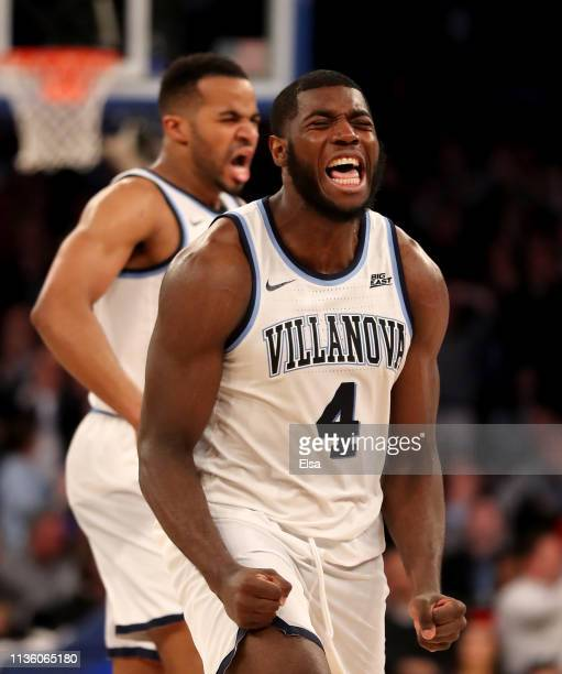 Eric Paschall and Phil Booth of the Villanova Wildcats celebrate in the final minutes of the game against the Xavier Musketeers during the semifinal...