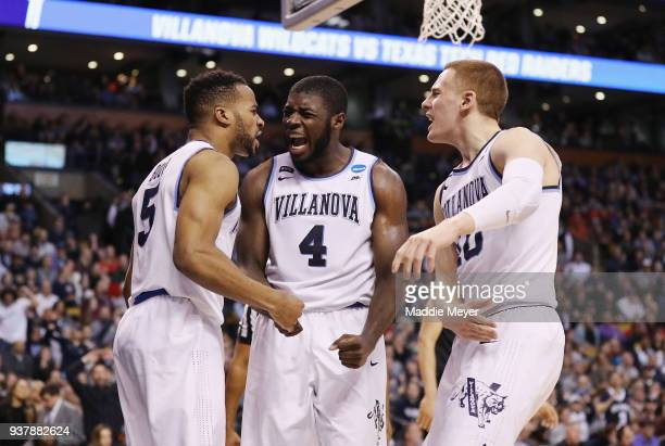 Eric Paschall celebrates with Phil Booth and Donte DiVincenzo of the Villanova Wildcats during the second half against the Texas Tech Red Raiders in...