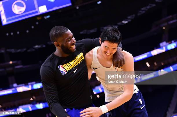 Eric Paschall of the Golden State Warriors and Yuta Watanabe of the Memphis Grizzlies hug prior to a game on December 9 2019 at Chase Center in San...