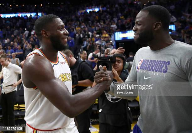 Eric Paschall of the Golden State Warriors is congratulated by Draymond Green after their win over the Portland Trail Blazers at Chase Center on...