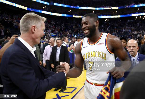 Eric Paschall of the Golden State Warriors is congratulated by head coach Steve Kerr after their win over the Portland Trail Blazers at Chase Center...