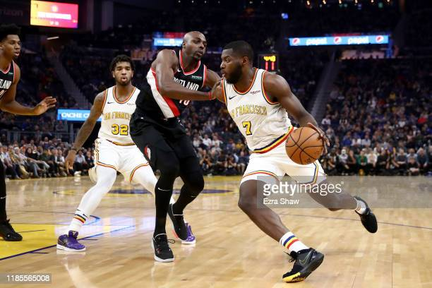 Eric Paschall of the Golden State Warriors is guarded by Anthony Tolliver of the Portland Trail Blazers at Chase Center on November 04 2019 in San...