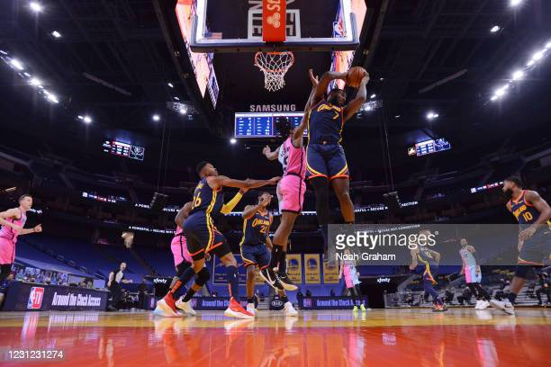 February 17: Eric Paschall of the Golden State Warriors rebounds the ball during the game against the Miami Heat on February 17, 2021 at Chase Center...