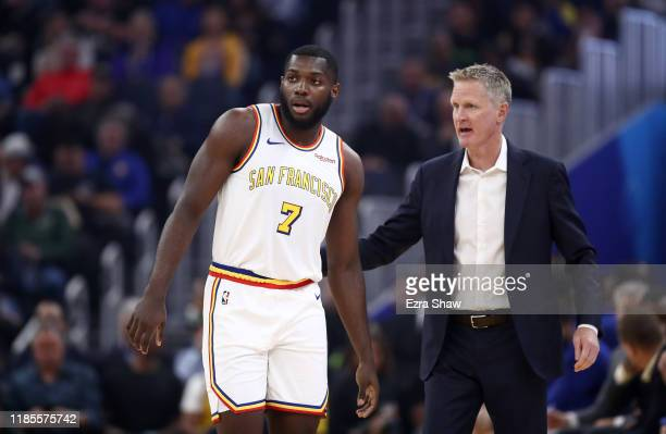 Eric Paschall of the Golden State Warriors talks with head coach Steve Kerr during their game against the Portland Trail Blazers at Chase Center on...