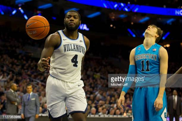 Eric Paschall of the Villanova Wildcats and Greg Malinowski of the Georgetown Hoyas react at the Wells Fargo Center on February 3 2019 in...