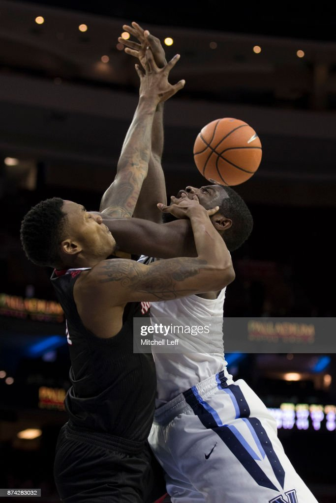 Eric Paschall #4 of the Villanova Wildcats attempts a shot against Kimani Jackson #35 of the Nicholls State Colonels in the second half at the Wells Fargo Center on November 14, 2017 in Philadelphia, Pennsylvania. The Villanova Wildcats defeated the Nicholls State Colonels 113-77.