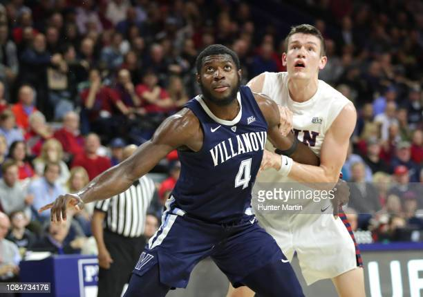 Eric Paschall of the Villanova Wildcats boxes out AJ Brodeur of the Pennsylvania Quakers during a game at The Palestra on the campus of the...