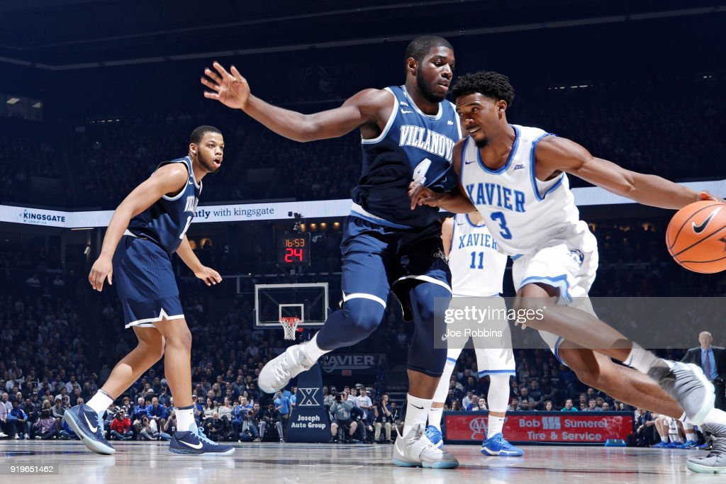 Eric Paschall #4 of the Villanova Wildcats defends against Quentin Goodin #3 of the Xavier Musketeers in the first half of a game at Cintas Center on February 17, 2018 in Cincinnati, Ohio.