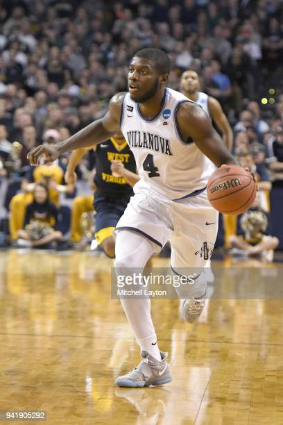 Eric Paschall of the Villanova Wildcats dribbles the ball during the 2018 NCAA Men's Basketball Tournament East Regional against the West Virginia...