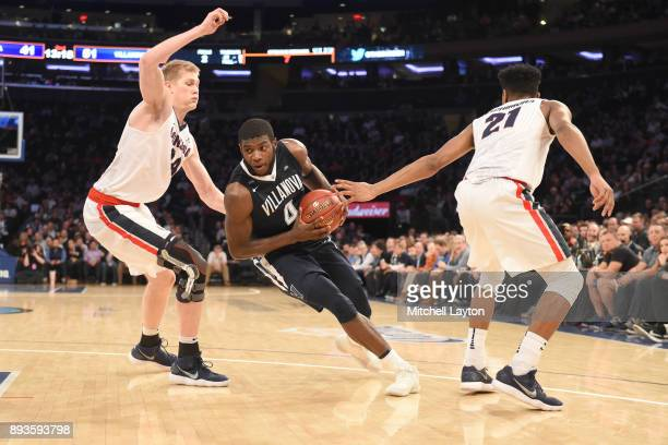 Eric Paschall of the Villanova Wildcats dribbles through Jacob Larsen and Rui Hachimura of the Gonzaga Bulldogs during the Jimmy V Classic college...