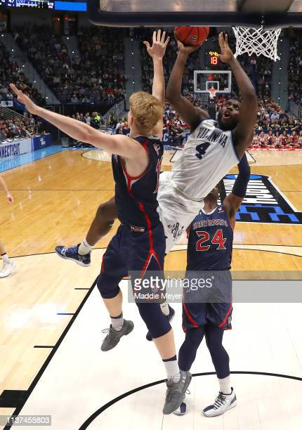 Eric Paschall of the Villanova Wildcats drives to the basket against Matthias Tass and Malik Fitts of the Saint Mary's Gaels in the second half...