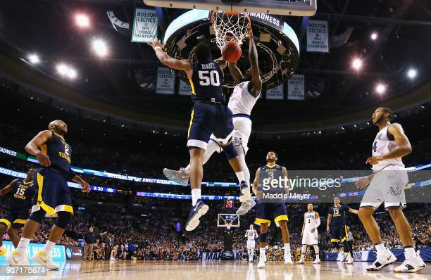 Eric Paschall of the Villanova Wildcats dunks the ball against Sagaba Konate of the West Virginia Mountaineers during the second half in the 2018...
