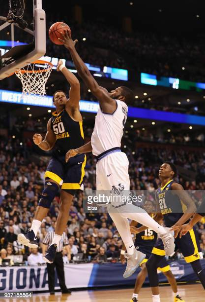 Eric Paschall of the Villanova Wildcats shoots the ball against Sagaba Konate of the West Virginia Mountaineers during the first half in the 2018...