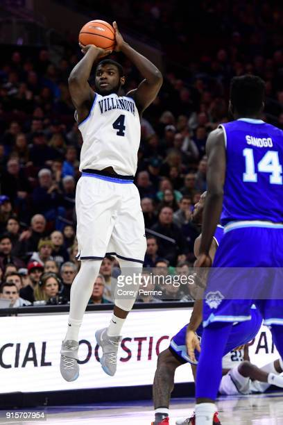 Eric Paschall of the Villanova Wildcats shoots the ball past Ismael Sanogo of the Seton Hall Pirates during the second half at the Wells Fargo Center...