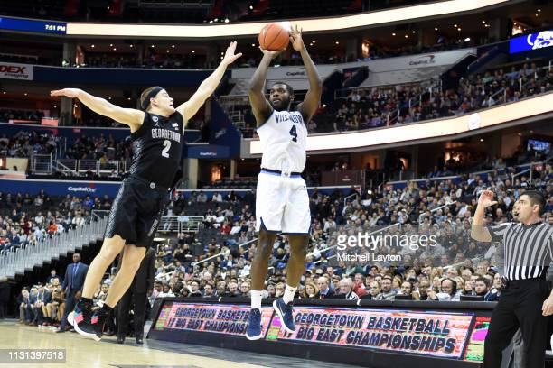 Eric Paschall of the Villanova Wildcats takes a jump shot over Mac McClung of the Georgetown Hoyas during a college basketball game at the Capital...