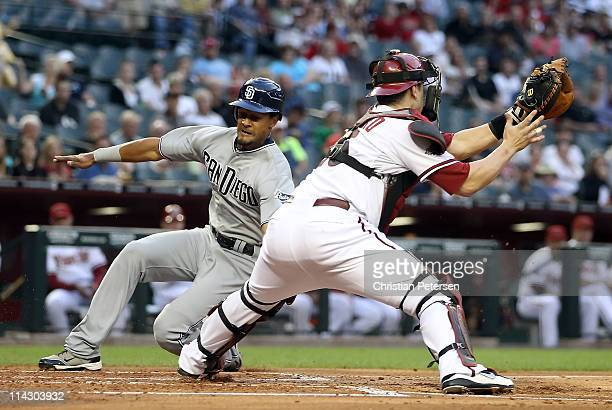 Eric Patterson of the San Diego Padres attempts to score a run past catcher Miguel Montero of the Arizona Diamondbacks during the second inning of...