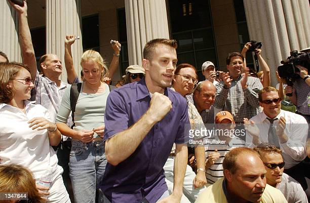 Eric Pauli cheers the guilty verdict in the David Westerfield trial August 21 2002 in San Diego California Westerfield was found guilty of the...