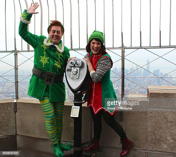 Eric Petersen as Buddy The Elf and Veronica Kuehn as Jovie from Elf The Musical visit the Empire State Building in celebration of the opening night...