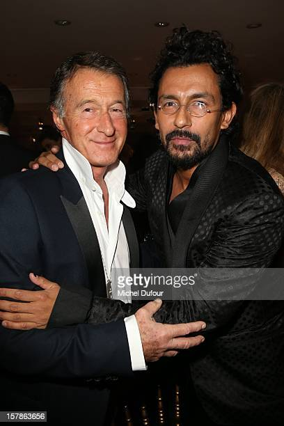Eric Pfrunder and Haider Ackermann attend the Babeth Djian Hosts Dinner For Rwanda To The Benefit Of AEM on December 6 2012 in Paris France