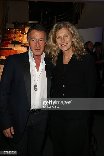 Eric Pfrunder and wife attend the Babeth Djian Hosts Dinner For Rwanda To The Benefit Of AEM on December 6 2012 in Paris France