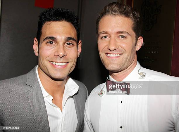 Eric Podwall and Matthew Morrison pose backstage at Matthew Morrison Back On Broadway One Night Only at the Beacon Theatre on August 1 2011 in New...