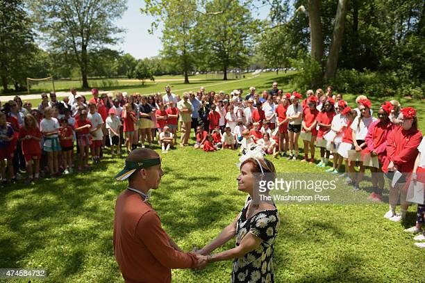 Eric Powell and Laura Stotz have a wedding ceremony at Woodley Gardens Park following field day for Christ Episcopal School on Friday May 22 2015 in...