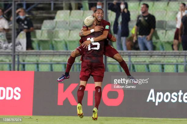 Eric Ramírez of Venezuela celebrates with teammate after scoring the first goal of his team during a match between Venezuela and Brazil as part of...