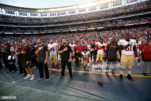 Eric Reid and Colin Kaepernick of the San Francisco 49ers kneel on the sideline during the anthem prior to the game against the San Diego Chargers at...