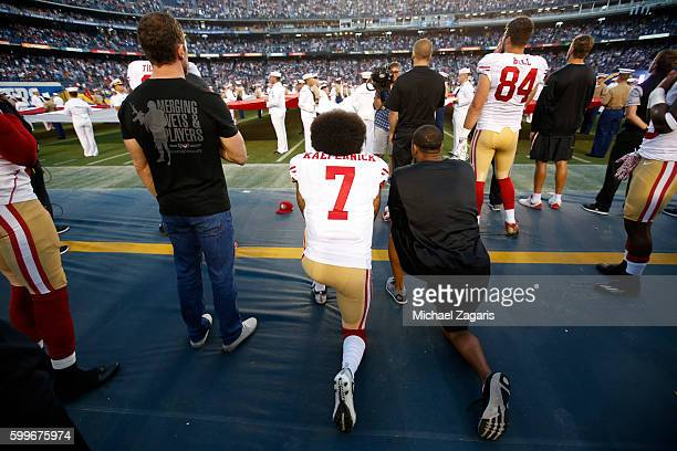 Eric Reid and Colin Kaepernick of the San Francisco 49ers kneel on the sideline during the anthem as free agent Nate Boyer stands prior to the game...