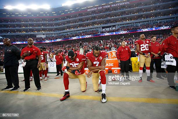 Eric Reid and Colin Kaepernick of the San Francisco 49ers kneel during the anthem prior to the game against the Los Angeles Rams at Levi Stadium on...