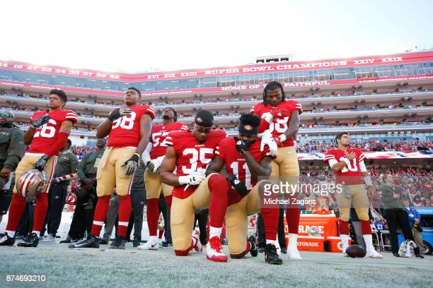 Eric Reid and Marquise Goodwin of the San Francisco 49ers kneel during the anthem prior to the game against the New York Giants at Levi's Stadium on...