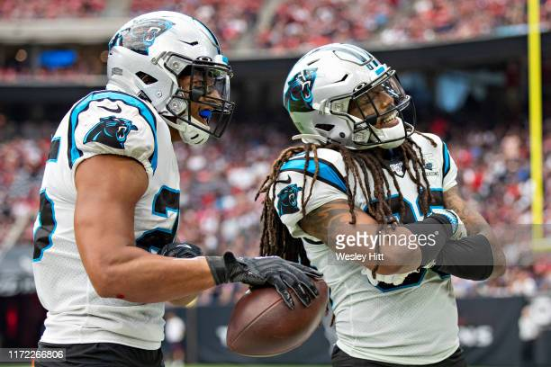 Eric Reid and Tre Boston of the Carolina Panthers celebrate after a fumble recovery during a game against the Houston Texans at NRG Stadium on...