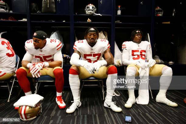 Eric Reid Eli Harold and Reuben Foster of the San Francisco 49ers relax in the locker room prior to the game against the Houston Texans at NRG...