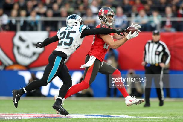 Eric Reid of Carolina Panthers battles for possession with Cameron Brate of Tampa Bay Buccaneers during the NFL game between Carolina Panthers and...
