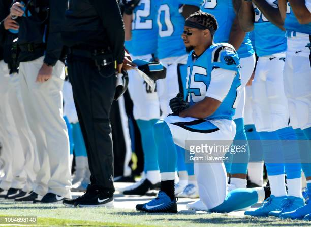 Eric Reid of the Carolina Panthers kneels during the anthem against the Baltimore Ravens at Bank of America Stadium on October 28 2018 in Charlotte...