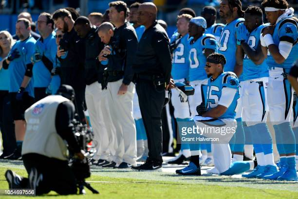 Eric Reid of the Carolina Panthers kneels for the national anthen during their game against the Baltimore Ravens at Bank of America Stadium on...
