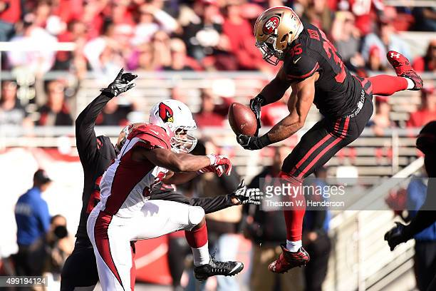 Eric Reid of the San Francisco 49ers breaks up a pass intended for David Johnson of the Arizona Cardinals during their NFL game at Levi's Stadium on...