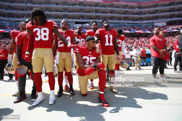 Eric Reid of the San Francisco 49ers leads the team in a 'call to attention' during the anthem prior to the game against the Carolina Panthers at...