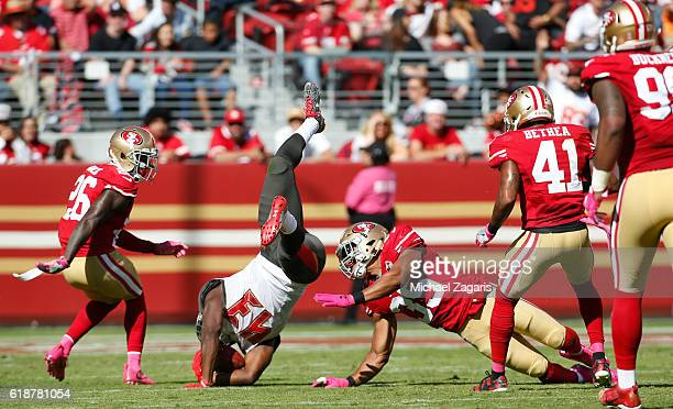 Eric Reid of the San Francisco 49ers upends Peyton Barber of the Tampa Bay Buccaneers during the game at Levi Stadium on October 23 2016 in Santa...