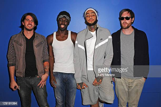 Eric Roberts Disashi LumumbaKasongo Travie McCoy and Matt McGinley of Gym Class Heroes pose at Y 100 radio station on October 13 2011 in Miami Florida