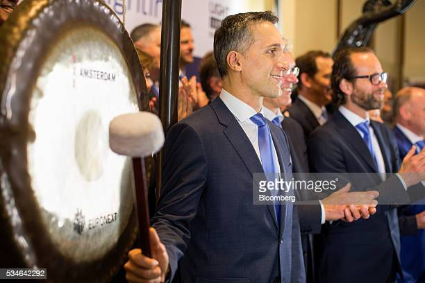Eric Rondolat chief executive officer of Philips Lighting NV bangs a gong to indicate the start of trading at Amsterdam Stock Exchange operated by...