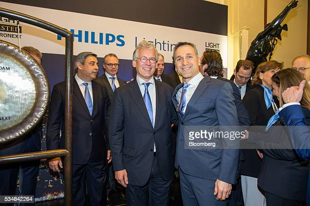Eric Rondolat chief executive officer of Philips Lighting NV center right and Frans van Houten chief executive officer of Royal Philips NV center...