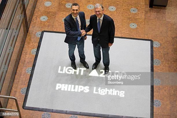 Eric Rondolat chief executive officer of Philips Lighting NV left and Frans van Houten chief executive officer of Royal Philips NV pose for a...